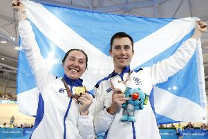 Katie and John Archibald celebrate winning their medals on the Gold Coast