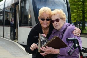 Valdis and Kristina took a trip on the new tram network. Picture: Jon Savage