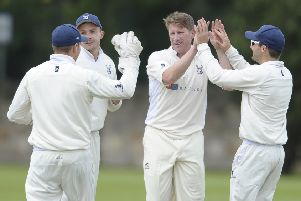 John Blain (third from right) celebrates the wicket of Michael Miler with his Grange team-mates. Pic: Neil Hanna