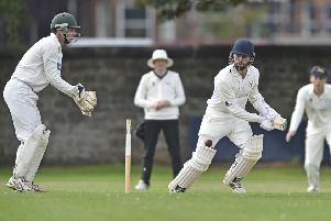 Grange star Dylan Budge hits out as Sam Flett keeps wicket for Corstorphine. Pic: Neil Hanna