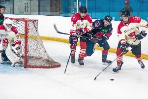 Racers with the puck. Picture: Ian Coyle