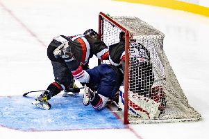 A Racers player ends up in the Blackburn net. 'Picture: Ian Coyle