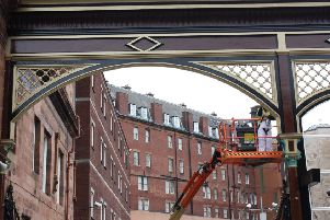 The historic gates have been restored to their original colour scheme. Picture: Contributed
