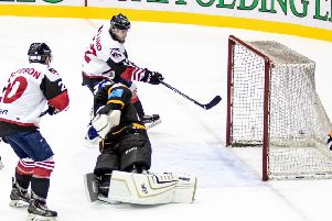 Racers star Michael Ireland tucks in a goal at the back door to make it 4-2. Picture: Ian Coyle
