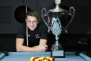 Ross Fernie cannot takes his eyes off the Scottish Open Pool Trophy. Pic: Alastair Linford