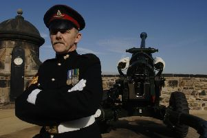 Sgt James Shannon (aka Shannon The Cannon) with the One O'Clock Gun. Picture: TSPL
