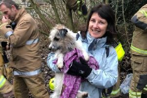 May Watson with her dog, Ethel, which was rescued by firefighters after becoming trapped on Corstorphine Hill