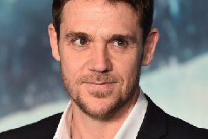 Scottish actor Jamie Sives poses for a photograph on the red carpet. Pic: Ben Stansall/AFP/Getty Images)
