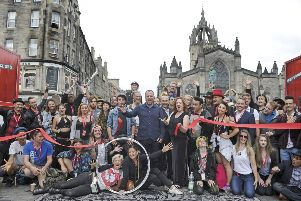 Edinburgh Festival Fringe Society's Shona McCarthy unveils the new Virgin Money Street Events on the Royal Mile with Fringe street performers'. Pic: Neil Hanna Photography