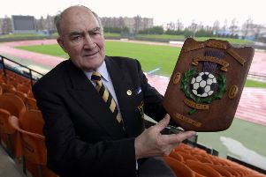 John Bain, ex manager of then Meadowbank Thistle now Livingston FC pictured at Meadowbank,with a trophy from when Meadowbank Thistle won the old 2nd division title.