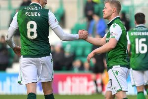 Vykintas Slivka,  scorer of Hibs second goal against Raith Rovers,  congratulates Daryl Horgan on opening the scoring for the Easter Road side