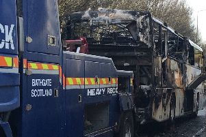 The fire-damaged bus.