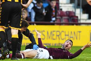 Hearts full-back Michael Smith lies grounded after tearing his thigh muscle against Auchinleck Talbot.