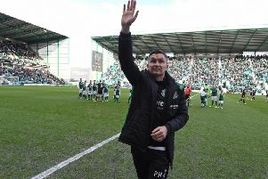 New Hibs boss Paul Heckingbottom salutes the home fans before his first game at Easter Road