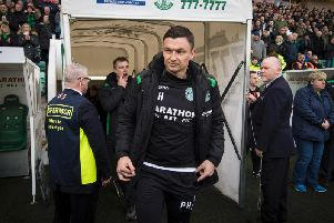 Paul Heckingbottom takes his place in the dugout for his first match as Hibs head coach
