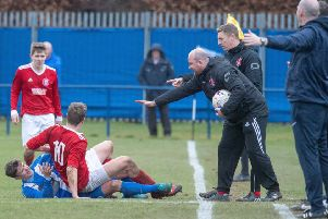 Penicuik's Steven Notman and Hill of Beath's Daniel Watt clash.