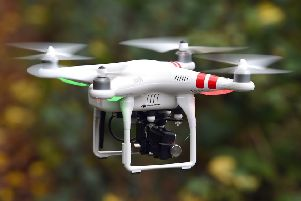 A wedding photographer who proposed to his girlfriend by drone has been fined after he was caught flying the craft over Edinburgh city centre. Picture: Joe Giddens/PA Wire