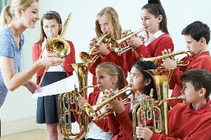 Group of students playing in a school orchestra together