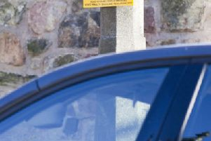 Parking notice outside Scottish primary where a �20 fine is issued for cars with the engine running