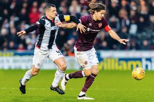Hearts midfielder Peter Haring on the ball in a previous meeting between the two sides