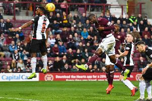 Clevid Dikamona headed Hearts in front before St Mirren drew level at Tynecastle.