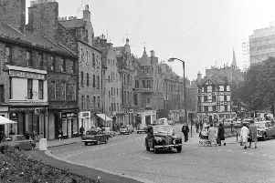 Living Memories supplement.  Bristo Street in Edinburgh in 1965 - Woolpack Inn pub to left and Parker's store to right.  The construction of the Appleton Tower is visible in the background.