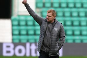Former Hibs boss Neil Lennon gives the early arrivals the thumbs-up as he returns to Easter Road with Celtic for their Scottish Cup quarter-final clash