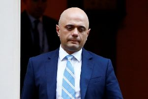 Britain's Home Secretary Sajid Javid is seen outside of Downing Street in London. Picture: Reuters/Henry Nicholls