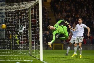 Conor Hazard's dive is in vain as the header from Christophe Berra (not pictured) loops into the net. Picture: SNS Group