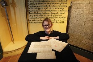 Vicky Garrington, curator at Museum of Edinburgh with Mary Queen of Scots original letters.