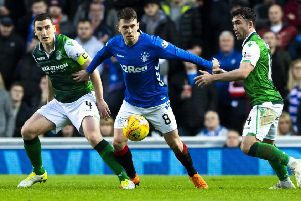 Paul Hanlon, Ryan Jack and Stevie Mallan in action during the last match between the two sides. Picture: SNS Group