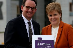 First Minister Nicola Sturgeon receives the Sustainable Growth Commission report from commission chair Andrew Wilson. Picture: Gordon Terris/The Herald/PA Wire