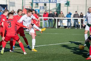 Edinburgh City's Blair Henderson fires in his 34th goal of the season