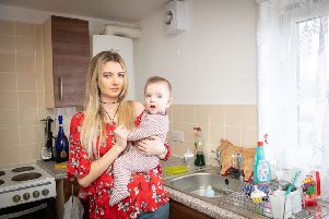 Laura Mcqueenie in her rat-infested Niddrie flat.