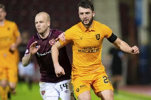 Craig Halkett in action for Livingston against Hearts' Steven Naismith. Picture: SNS Group