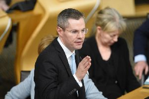 Derek Mackay will move to change SNP policy and back a separate Scots currency next month