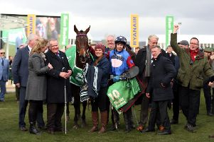 Owner Andrew Gemmell, third from left, with Paisley Park and jockey Aidan Coleman in the winner's enclosure after victory in the Stayers' Hurdle at Cheltenham. Picture: PA.