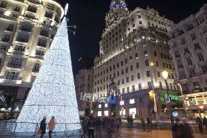 A Christmas tree illumniates the Gran Via in Madrid. Picture: AFP/Getty