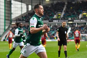Marc McNulty turns away in celebration after opening the scoring for Hibs against Motherwell