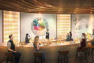 A computer-generated image of how the Johnnie Walker visitor attraction will look in the former House of Fraser store in Princes Street
