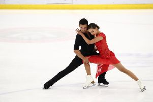 Lewis Gibson, pictured with partner Lilah Fear, said he was pleased with the couple's score in the rhythm dance in Japan.