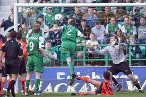 Gary Smith heads home Hibs' winning goal in a thrilling 3-2 contest