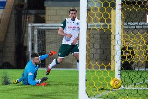 Stevie Mallan wraps up the points for Hibs as he passed the ball beyond Liam Kelly.