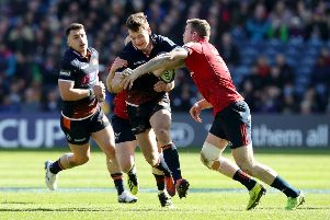 Edinburgh's Chris Dean is tackled by Keith Earis of Munster. Picture: Getty