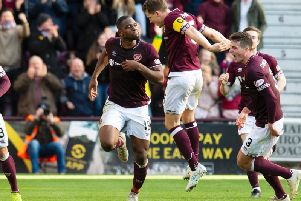 Hearts players celebrate Uche Ikpeazu's winner against Aberdeen. Picture: SNS