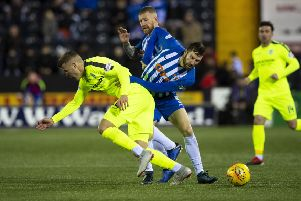 Florian Kamberi tangles with Kirk Broadfoot during the last meeting between the two sides. Picture: SNS Group