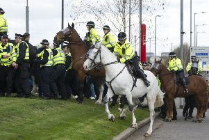 Police endeavour to restrain Old Firm fans ahead of the Celtic-Rangers match last weekend (Picture: John Devlin)