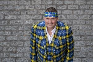 A portrait of former Scotland rugby international Doddie Weir will be auctioned off to raise funds for MND. Picture: PA