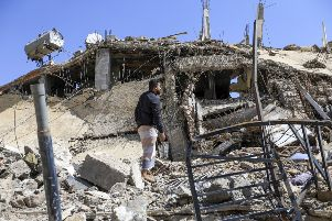 A Yemeni man goes through the wreckage of a building that was reportedly destroyed in a Saudi-led coalition air strike in the capital Sanaa on September 5, 2018. Pic: Mohammed Huwais/AFP/Getty Images