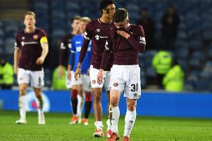 Substitute Bobby Burns trudges off the Ibrox pitch following another defeat in Glasgow. Pic: SNS